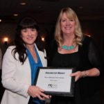 Tracy Leach receiving the Kern Citizens for Energy Award of Merit from PRSA Central CA Board President Jill Wagner.